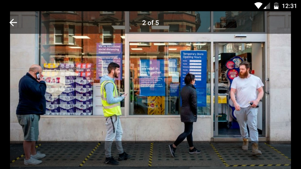 Queuing outside Tesco Melcombe Street during the height of the Coronavirus on 31st March 2020, with CCG reflected in the windows